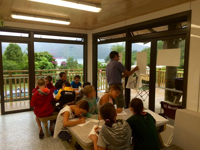 Nic demonstrating to the children in the new kitchen facilities.